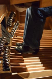 The organ requires certain shoes to press the pedals. This also gives the organist a more professional look.